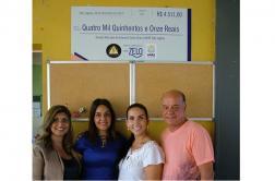 Grupo funerário doa cheque e promove lanche na Apae Sete Lagoas